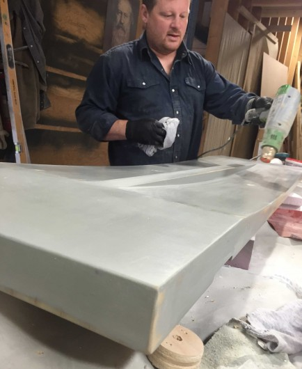 Szolyd's Chris Shannon working on the plug for the new ductal UHPC bench to be launched by Landscape Furnishings