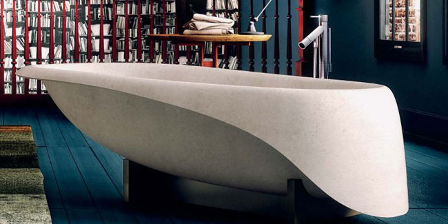 cream coloured concrete bathtub