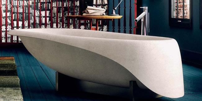 cream coloured concrete bathtub